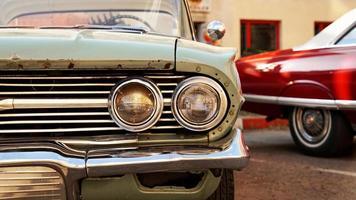 Retro car. Old vintage car. Headlight close up photo