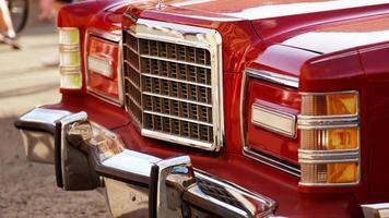 Red retro car. Old vintage car. Headlight close up photo