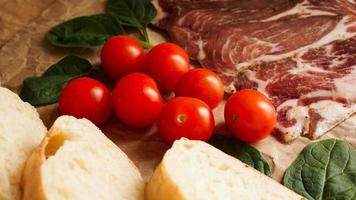 Bread slices, cherry tomatoes, spinach and ham. Ingredients photo