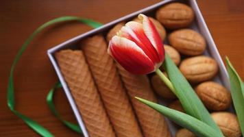 Shortbread cookies and tulips. Gift to the woman photo