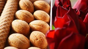 Shortbread cookies and tulips. Gift to the woman. photo