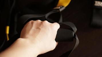 Close up on hands doing suspension training photo