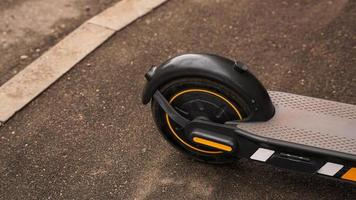 Close-up photo of the rear wheel of an electric scooter.