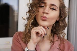 Beautiful funny pretty curly lady positive good mood photo