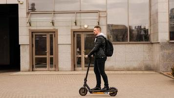 Tall man on an electric scooter photo