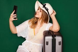 Elegant european woman taking selfie before vacation photo