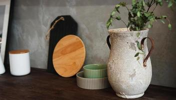 A vase with dry flowers on a table. Scandinavian classic kitchen photo