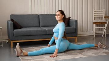 A woman in a blue tracksuit sits on a twine photo