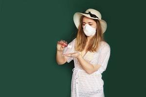 Beautiful girl with Medical mask on the face. Coronavirus photo