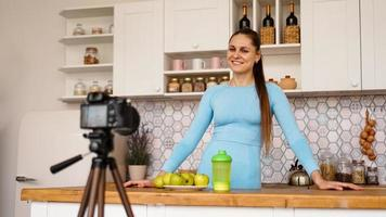 Satisfied healthy young girl recording her video blog photo