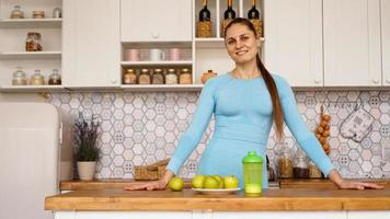 A beautiful woman in the kitchen. She is friendly photo