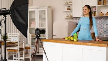 A woman in a tracksuit records a video blog photo