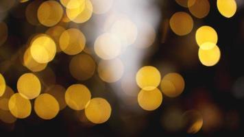 Defocused gold lights on the black background photo