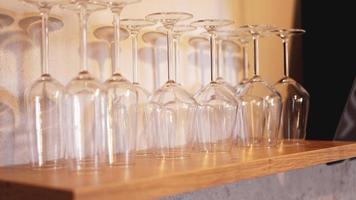 Lots of wine glasses on shelf photo