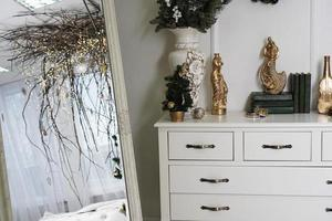 Bright white room with canopy of branches - christmas decoration photo