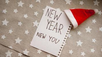 texto año nuevo nuevo tú en el cuaderno de año nuevo foto