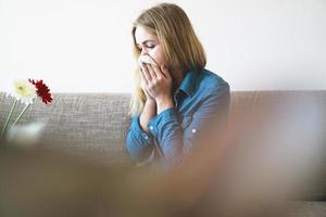 Spring cold or allergies. Attractive girl is allergic to flowers photo