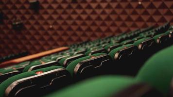 Vintage cinema theater movies audience retro seating seats, green photo