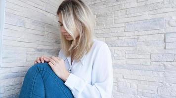 Sad or Depressed Young Beautiful Woman photo