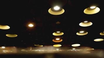 Spot lights in cinema hall on ceiling photo