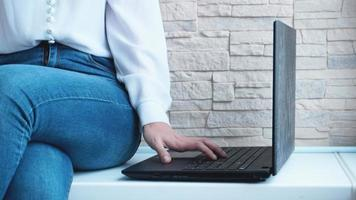 Woman working at home office hand on keyboard close up photo