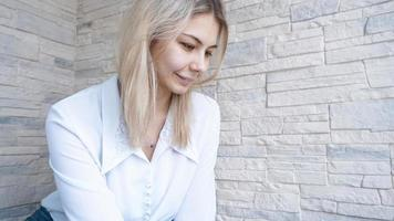 Side view. Young business woman looking down photo