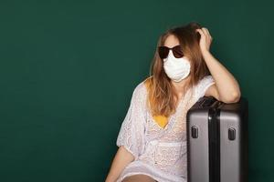 Beautiful girl with Medical mask on the face photo