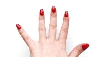 Beautiful female hand with red manicure and nail photo