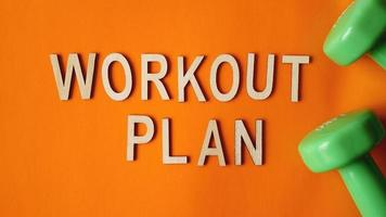 Fitness concept, workout plan. Green dumbbells photo