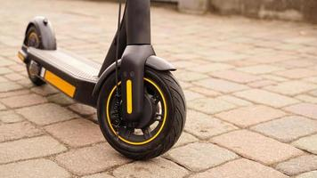 A close-up of the front wheel of an electric scooter photo