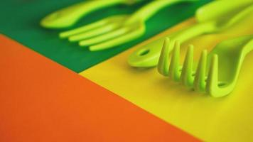 Set of green garden tools on green and yellow background photo