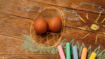 Easter eggs in a basket. Drawing with colored chalk photo