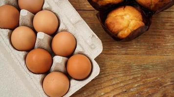 A tray with eggs and fresh tasty muffins in paper photo