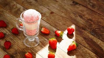 Strawberry and vanilla ice cream in a glass glass photo