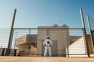 Astronaut on futuristic city background, glimpse at future photo