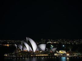 Sydney city harbor with opera house landmark skyline at night in Australia photo