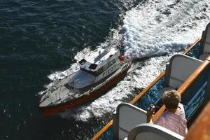 Cruise passenger watching the Pilot boat come alongside photo