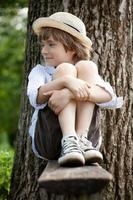 Fair-haired boy in sneakers photo