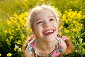 Portrait of a cheerful little girl photo