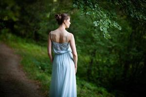Photographed from the back of a young woman photo