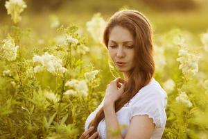 Beautiful young woman of high wildflowers photo