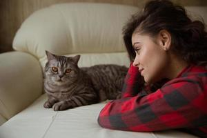 Girl and a big gray purebred cat photo