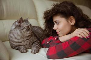 Young woman and big gray cat photo