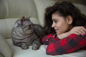 Young woman looks at a big cat photo