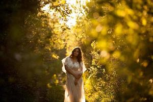Woman in a dress at sunset photo