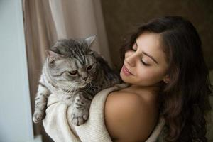 Girl holding a big gray cat photo