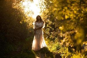 Girl in a dress at sunset photo
