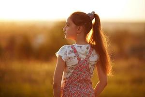 Little girl looks into the distance photo