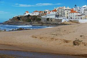 Landscape with ocean beach and houses photo