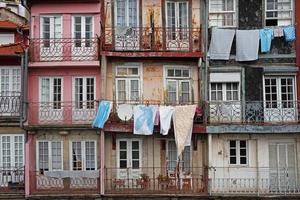 View of the facades of houses with balconies photo